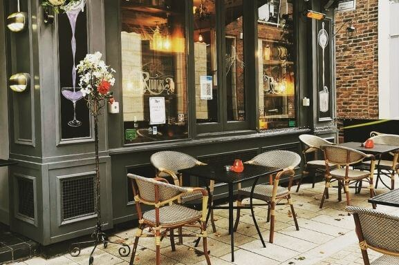 A photo of the outdoor seating area outside Riddles Bar in Altrincham